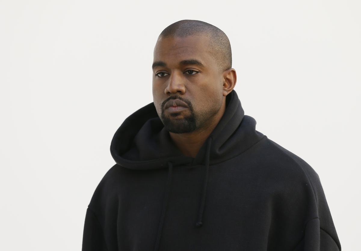 Kanye West poses before Christian Dior 2015-2016