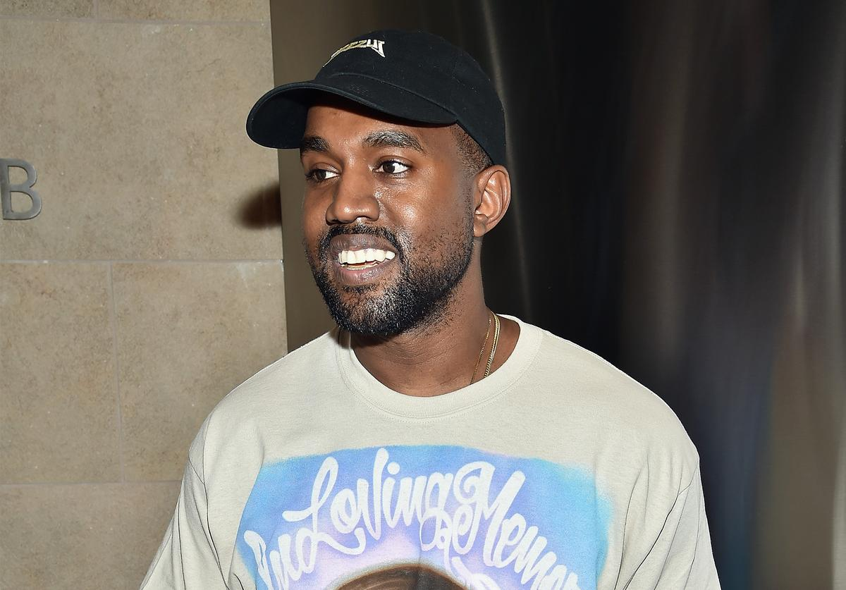 Kanye West wearing a t-shirt in memory of his mother at the Yeezy season 3 sow