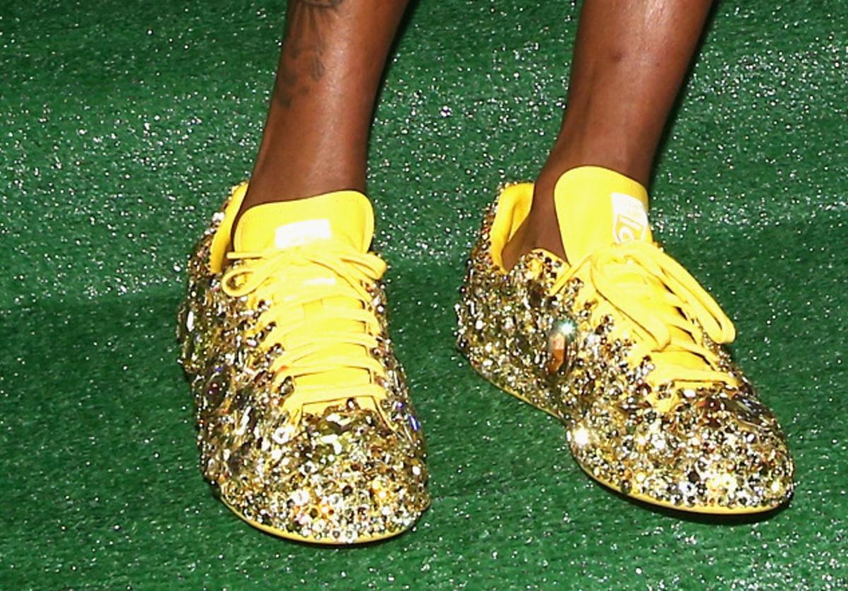 Pharrell at an 'I am Other' event in Adidas Superstars.
