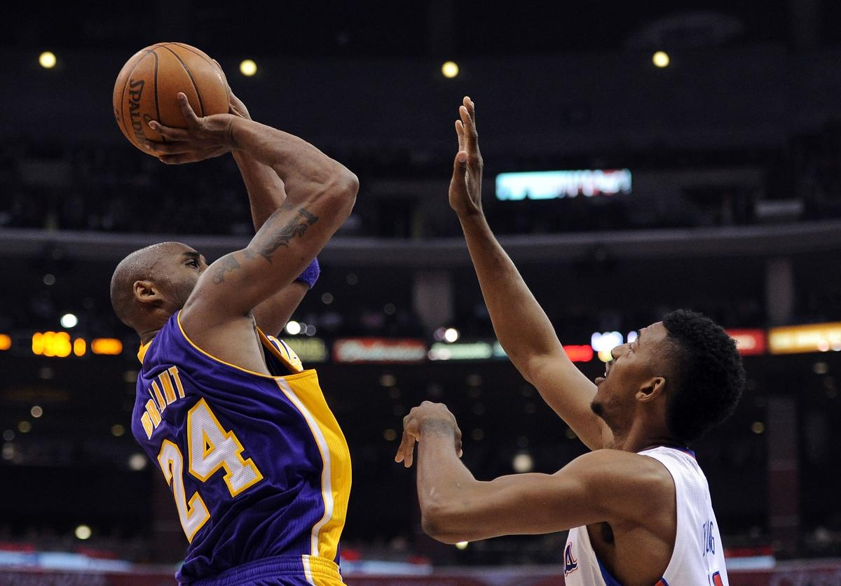 Kobe Bryant #24 of the Los Angeles Lakers shoots a jumper in front of Nick Young #11 of the Los Angeles Clippers at Staples Center on April 4, 2012 in Los Angeles, California.