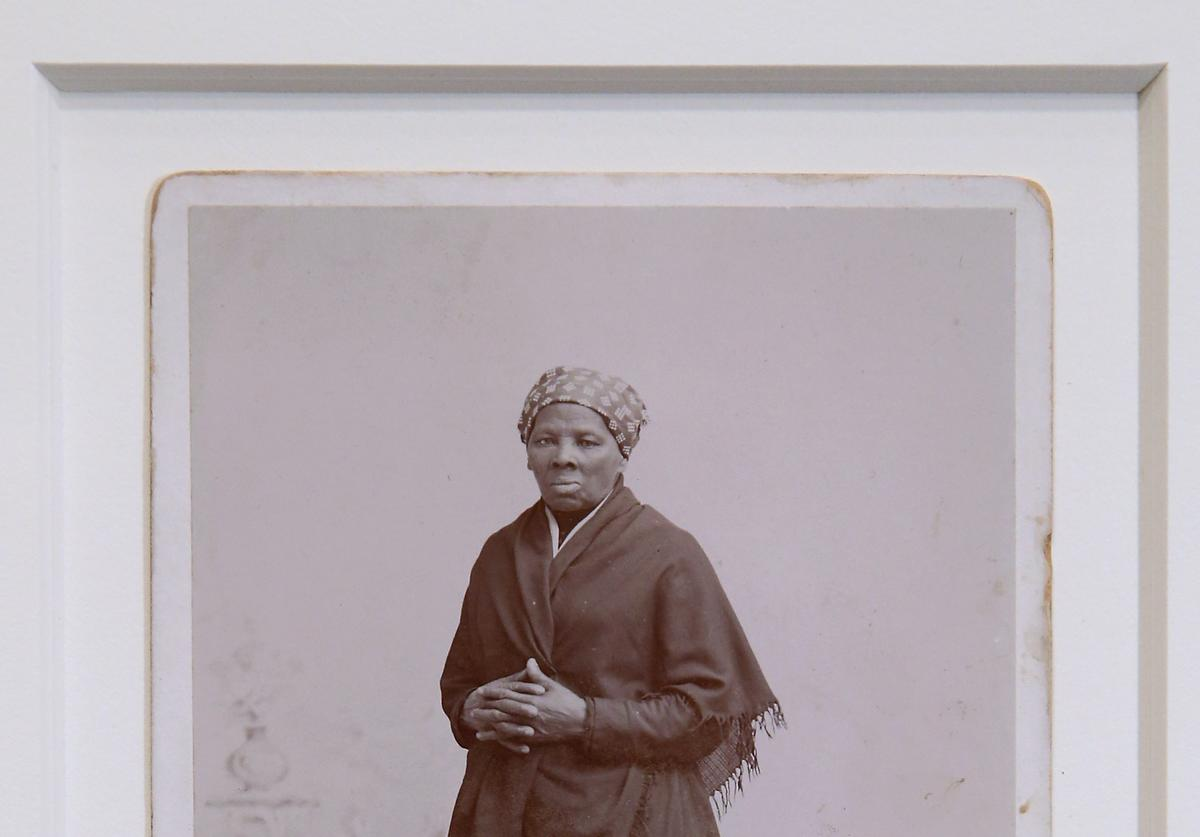 A recently-found photograph of escaped slave, abolitionist and Union spy Harriet Tubman that was acquired by the Smithsonian is displayed before a hearing of the House Administration Committee in the Longworth House Office Building on Capitol Hill June 17, 2015 in Washington, DC. Auburn, New York, photographer H. Seymour Squyer made the photograph around 1885. Born into slavery, Tubman used a network of antislavery activists and safe houses known at the Underground Railroad to help lead about 13 missions to rescue about 70 enslaved family and friends.