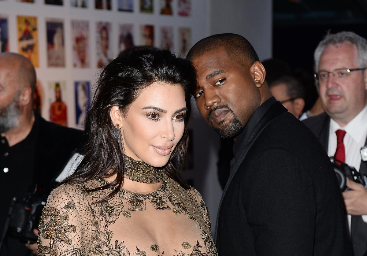 Kim Kardashian and Kanye West a the the Vogue 100 Festival