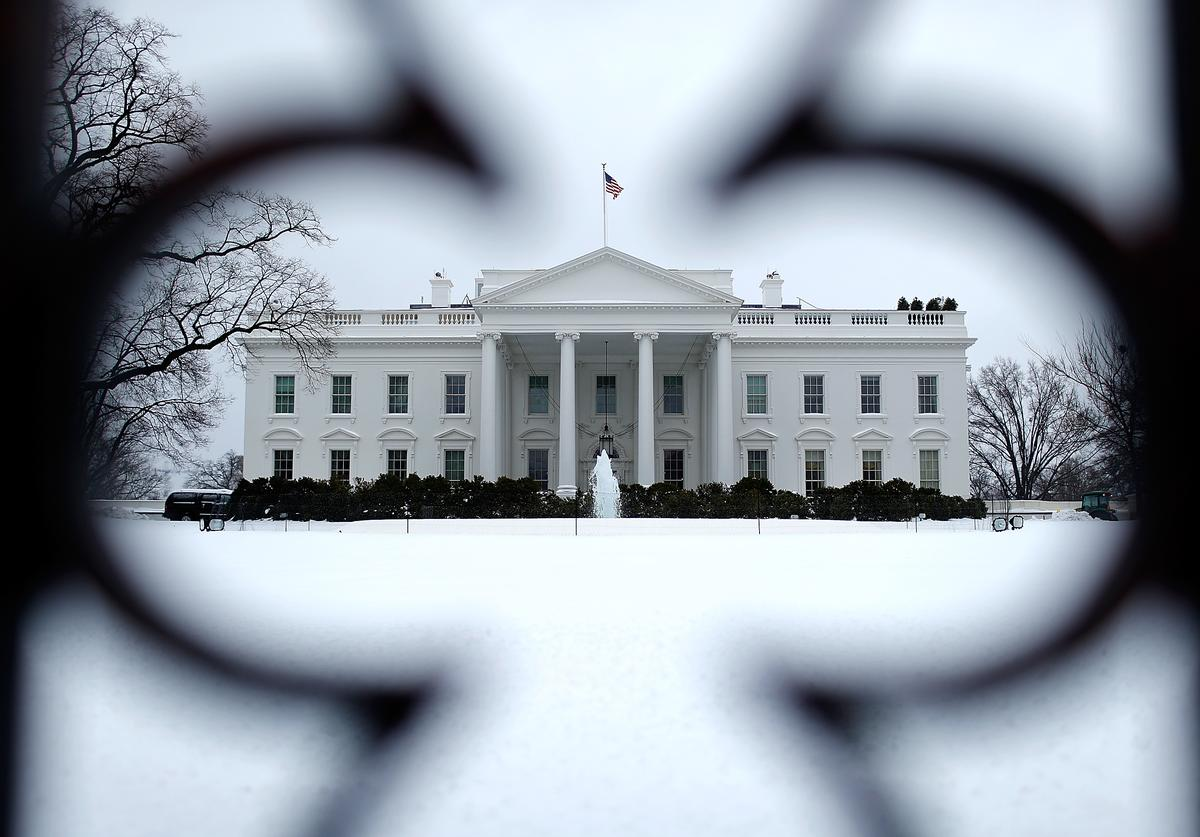 The White House north lawn is covered in snow February 13, 2014 in Washington, DC. The east coast of the U.S. was hit with a winter storm leaving up to 12 inches of snow on the ground in parts of the Washington, DC area.