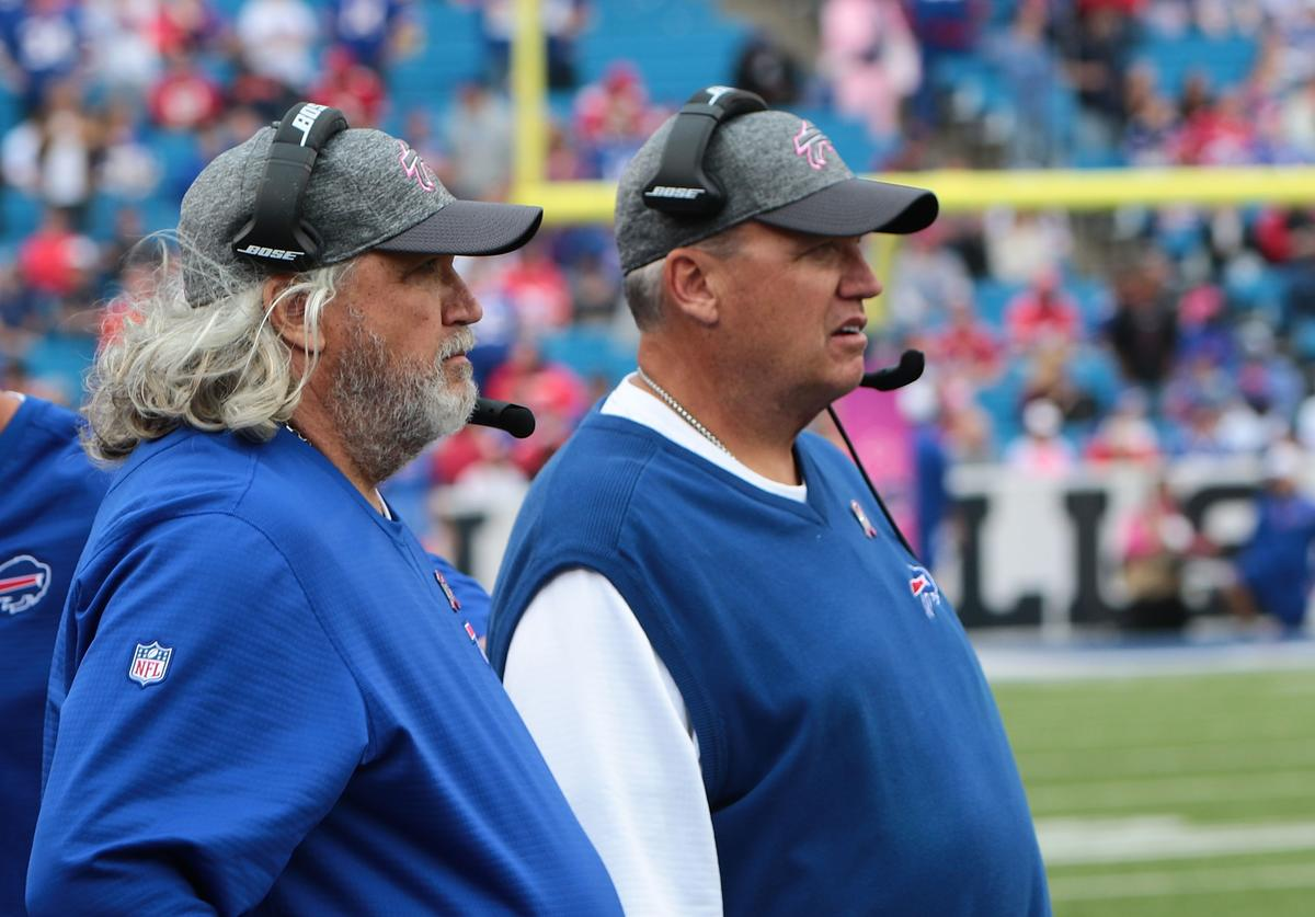 Head coach Rex Ryan of the Buffalo Bills and his brother coach Rob Ryan watch from the side lines during the second half against the San Francisco 49ers at New Era Field on October 16, 2016 in Buffalo, New York.