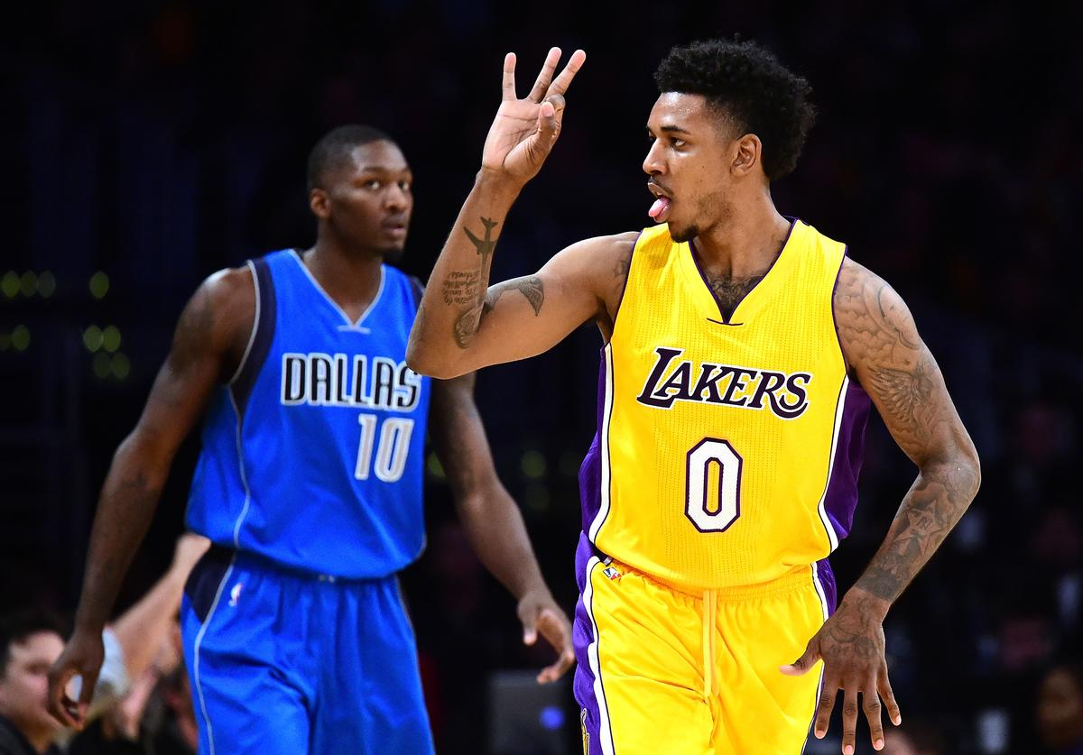 Nick Young #0 of the Los Angeles Lakers reactst to his three pointer in front of Dorian Finney-Smith #10 of the Dallas Mavericks during the first half at Staples Center on December 29, 2016 in Los Angeles, California.