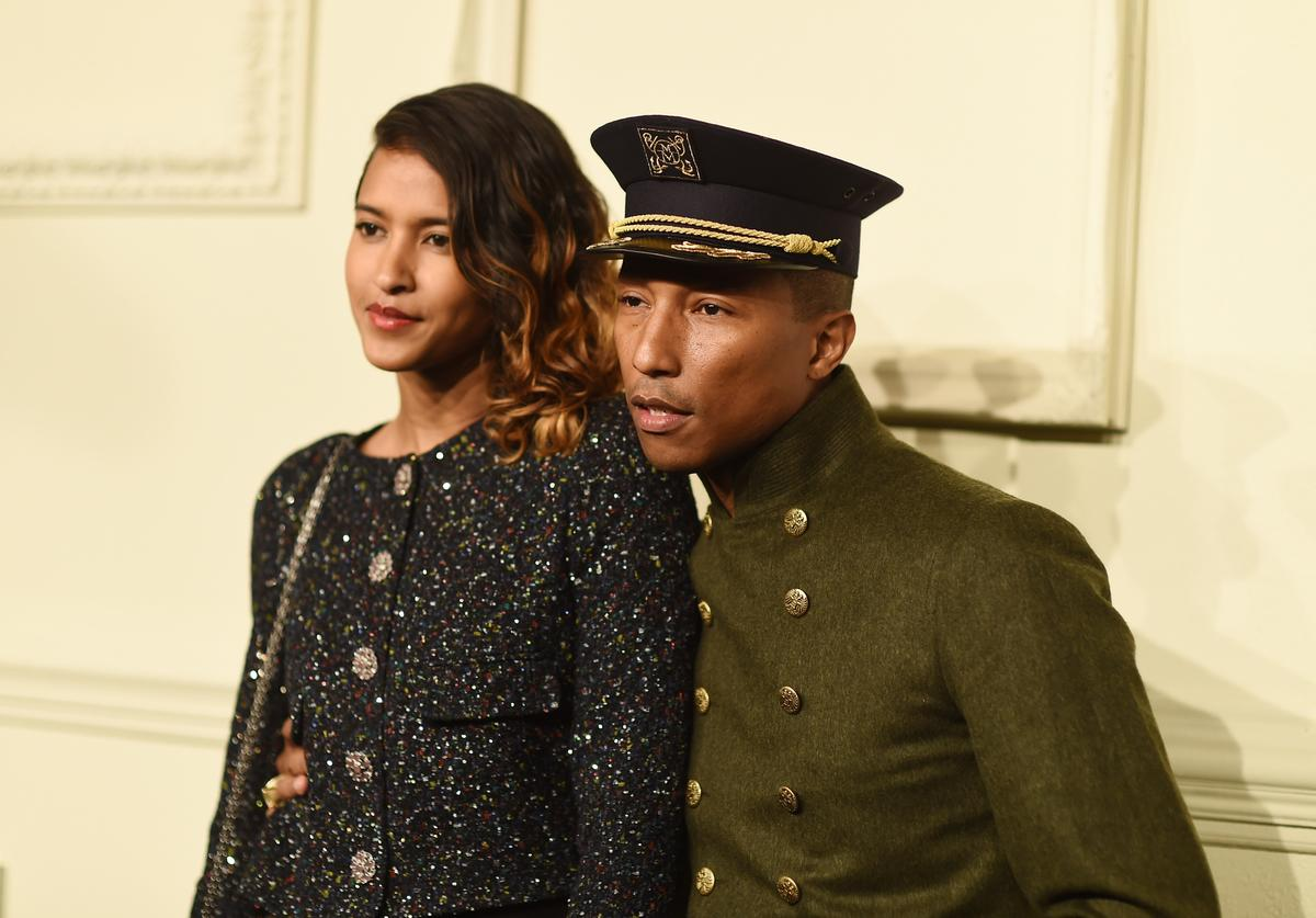 elen Lasichanh and Pharrell Williams attend the CHANEL Paris-Salzburg 2014/15 Metiers d'Art Collection at Park Avenue Armory on March 31, 2015 in New York City.