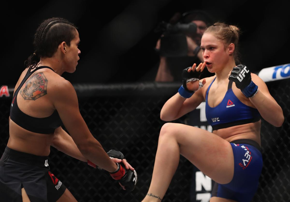 Ronda Rousey kicks Amanda Nunes of Brazil in their UFC women's bantamweight championship bout during the UFC 207 event on December 30, 2016 in Las Vegas, Nevada.
