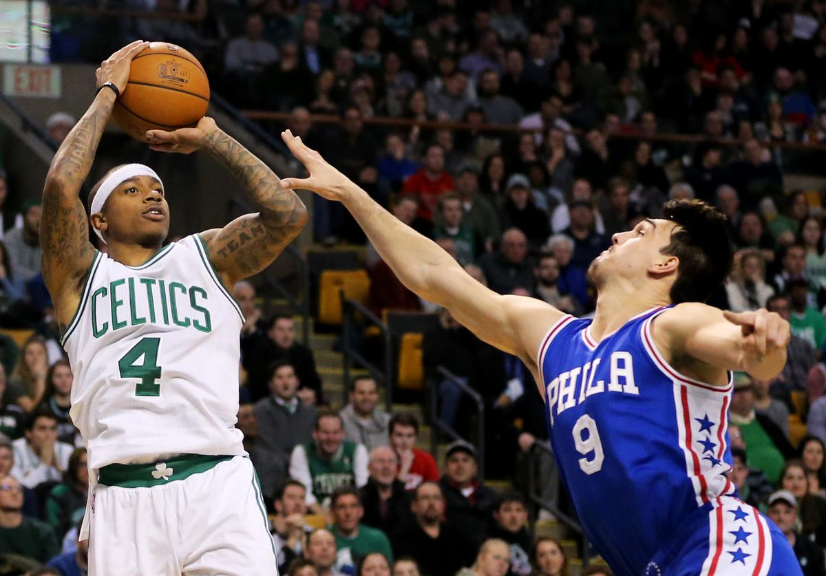 Isaiah Thomas #4 of the Boston Celtics takes a shot against Dario Saric #9 of the Philadelphia 76ers during the second half at TD Garden on January 6, 2017 in Boston, Massachusetts. The Celtics defeat the 76ers 110-106.