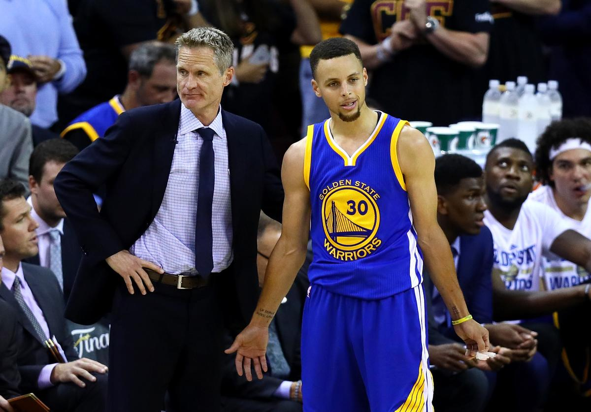 Steve Kerr of the Golden State Warriors and Stephen Curry #30 react in the second half against the Cleveland Cavaliers in Game 6 of the 2016 NBA Finals at Quicken Loans Arena on June 16, 2016 in Cleveland, Ohio.