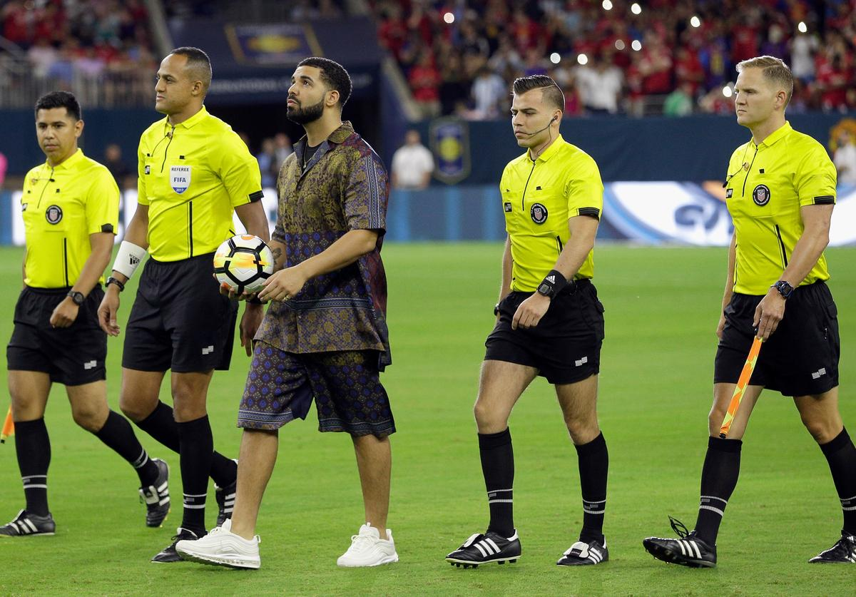 Rapper/Singer Drake brings out the game ball with the officials at NRG Stadium on July 20, 2017 in Houston, Texas