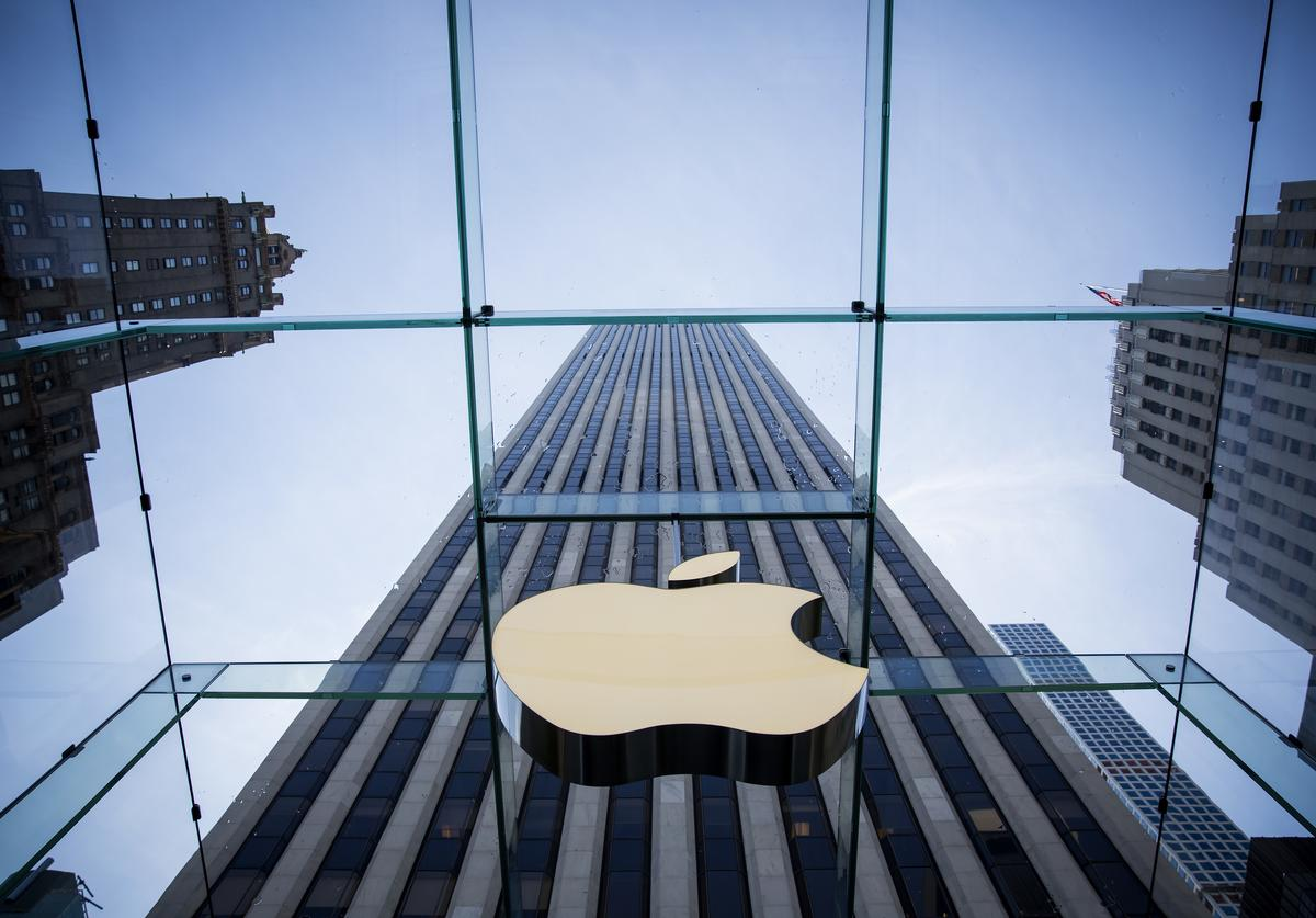The Apple logo is displayed at the Apple Store June 17, 2015 on Fifth Avenue in New York City. The company began selling the watch in stores Wednesday with their reserve and pick up service. Previously the product could only be ordered online