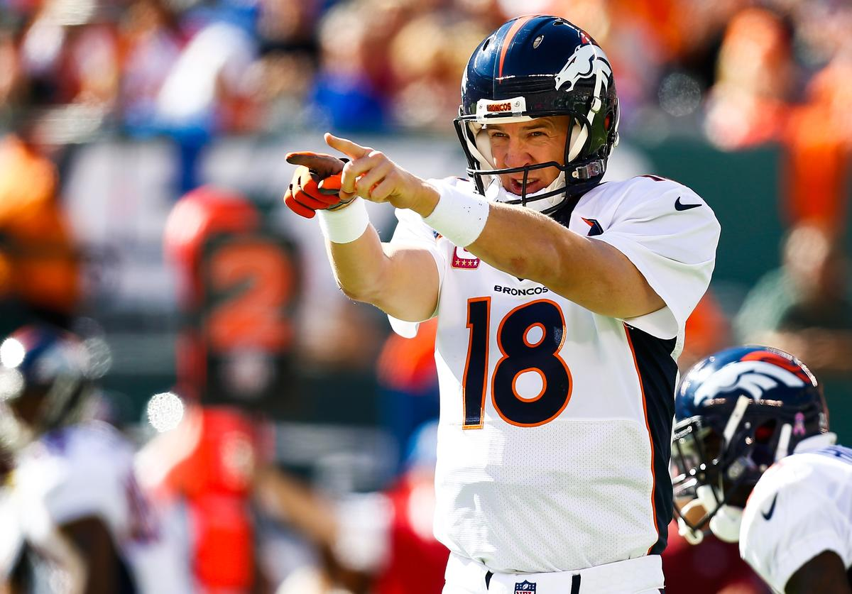 Peyton Manning #18 of the Denver Broncos yells to teammates in the second quarter during a game against the New York Jets at MetLife Stadium on October 12, 2014 in East Rutherford, New Jersey