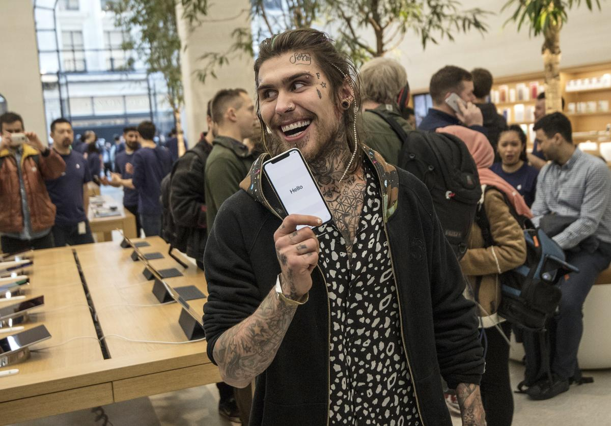 Marco Pierre White Jr poses with an iPhone X after being the first to buy one upon its release in the U.K, on November 3, 2017 in London, England. The iPhone X is positioned as a high-end, model intended to showcase advanced technologies such as wireless charging, OLED display, dual cameras and a face recognition unlock system