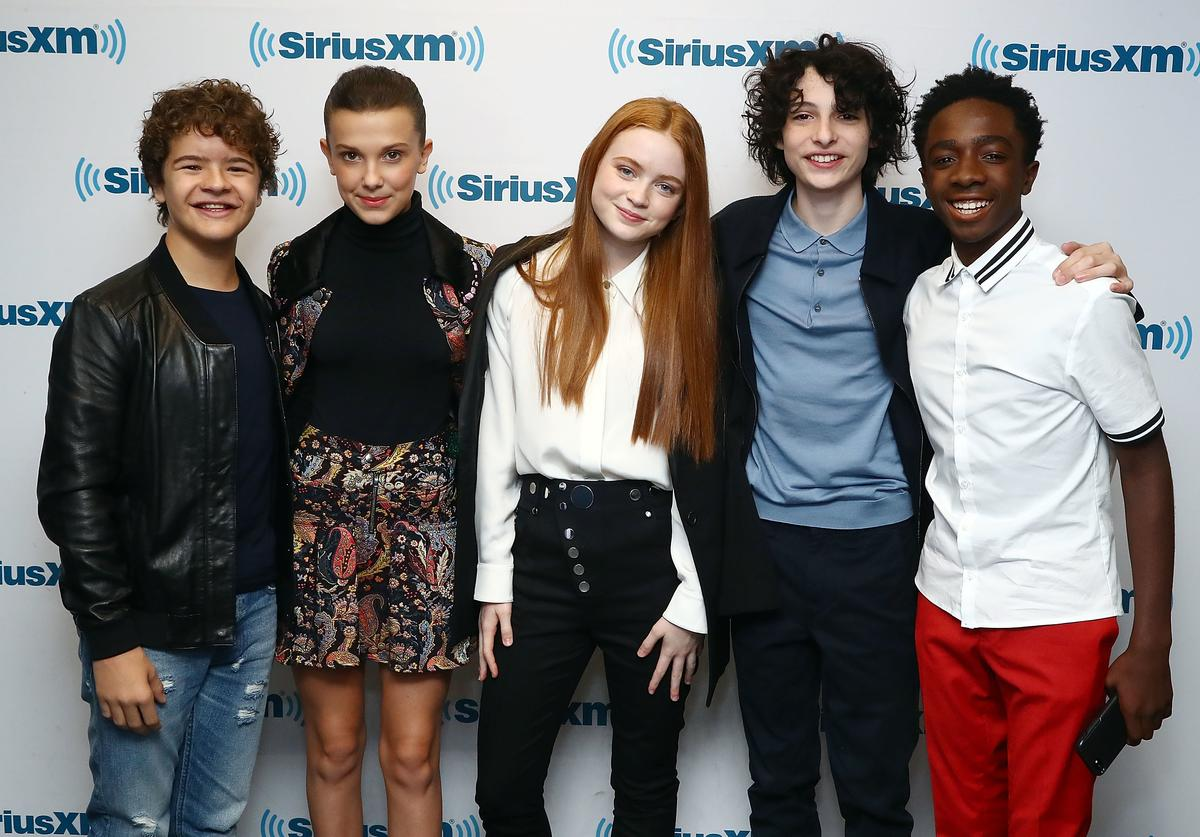 Actors Gaten Matarazzo, Millie Bobby Brown, Sadie Sink, Finn Wolfhard and Caleb McLaughlin attend SiriusXM's 'Town Hall' cast of Stranger Things on SiriusXM's Entertainment Weekly Radio on November 1, 2017 in New York City