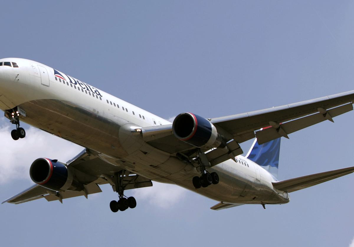 A Delta flight lands at the Salt Lake City International Airport August 19, 2004 in Salt Lake City, Utah. Delta is trying to restructure debt to avoid going into bankruptcy and there have been reports that Delta is considering closing a hub in Salt Lake City, Utah