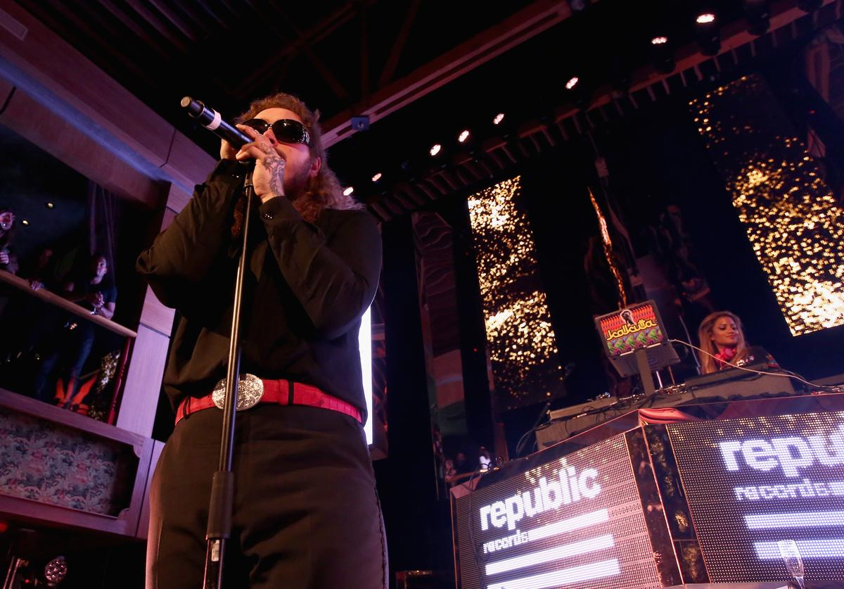 Post Malone performs onstage during the VMA after party hosted by Republic Records and Cadillac at TAO restaurant at the Dream Hotel on August 27, 2017 in Los Angeles, California