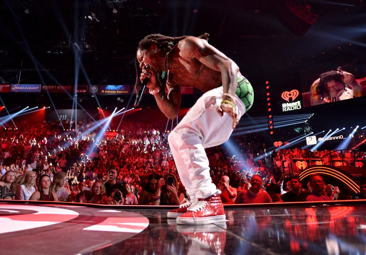Rapper Lil Wayne performs onstage at the 2015 iHeartRadio Music Festival at MGM Grand Garden Arena on September 18, 2015 in Las Vegas, Nevada