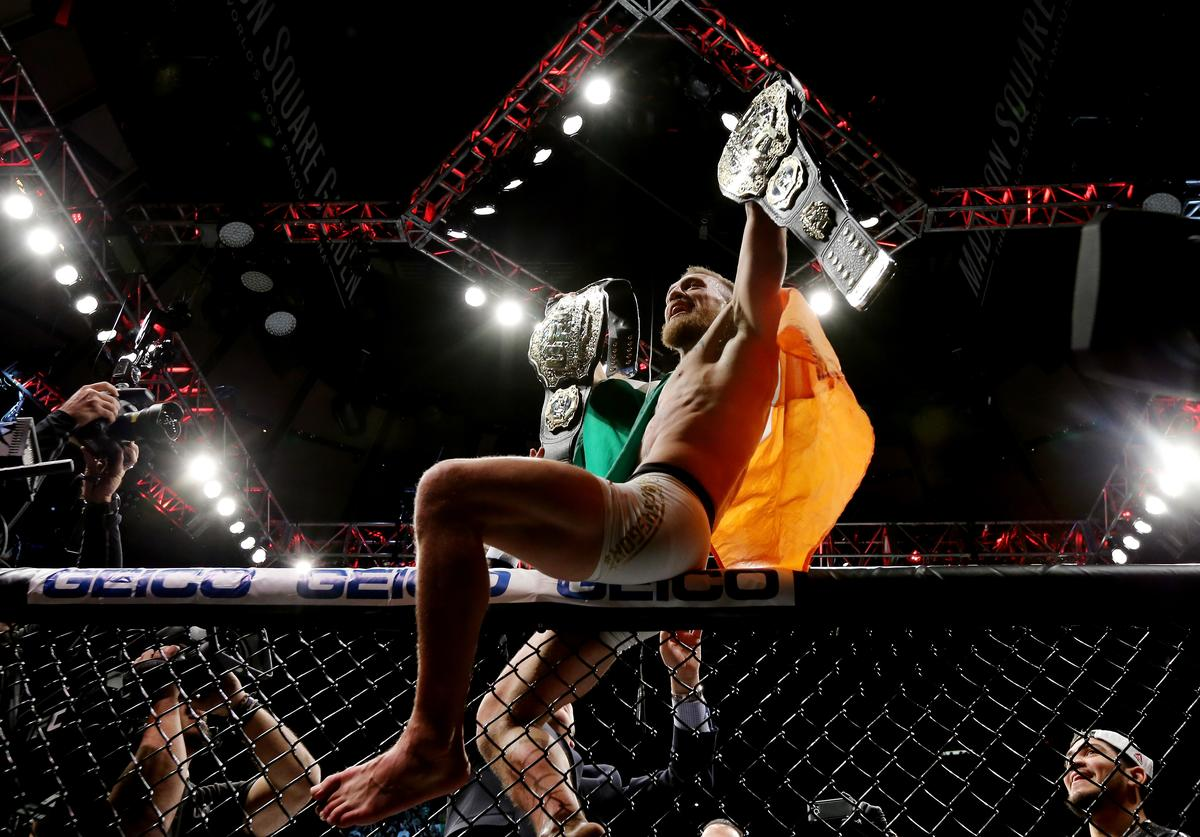 Conor McGregor of Ireland celebrates his KO victory over Eddie Alvarez of the United States in their lightweight championship bout during the UFC 205 event at Madison Square Garden on November 12, 2016 in New York City