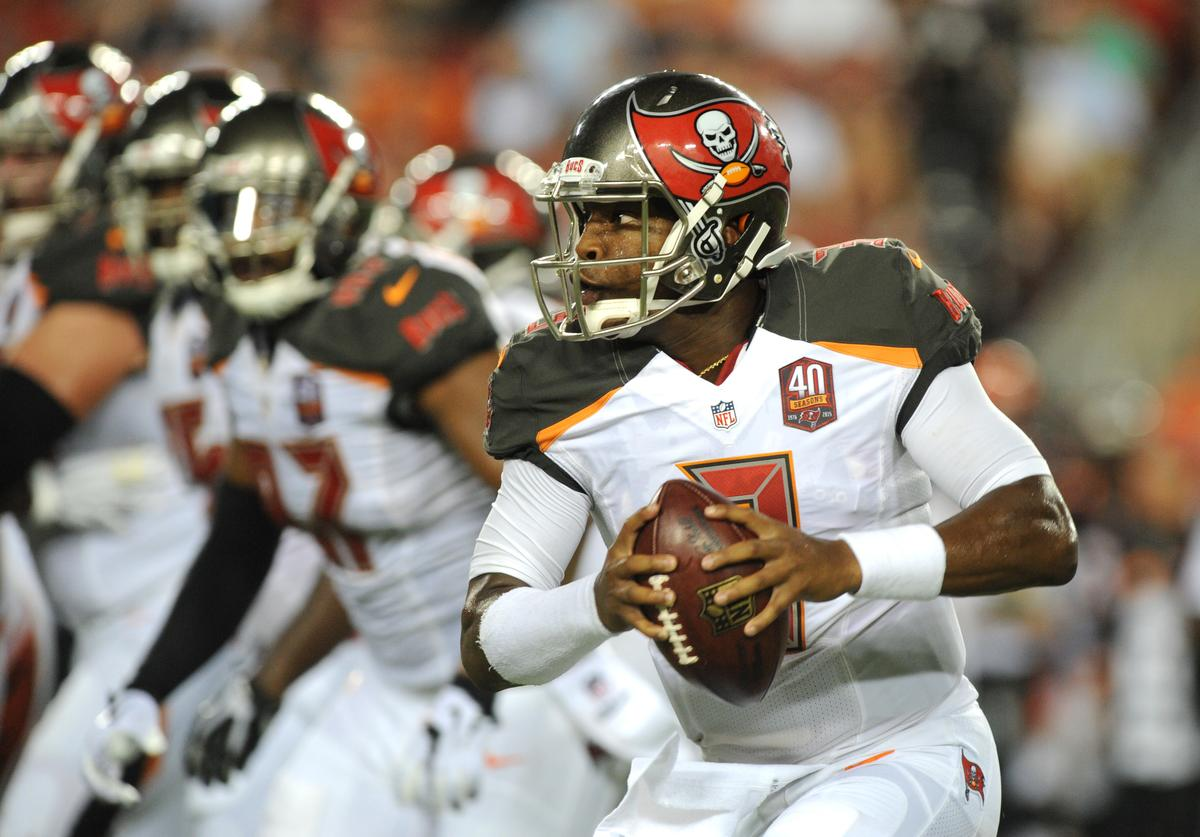 Quarterback Jameis Winston #3 of the Tampa Bay Buccaneers scrambles against the Cincinnati Bengals in the first quarter at Raymond James Stadium on August 24, 2015 in Tampa, Florida