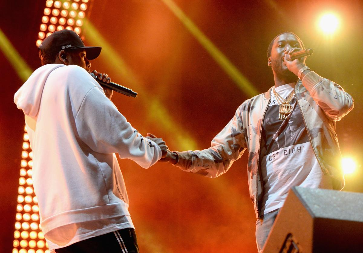 Jay Z (L) and Meek Mill perform during a surprise encore on the Liberty Stage at the 2017 Budweiser Made in America festival - Day 2 at Benjamin Franklin Parkway on September 3, 2017 in Philadelphia, Pennsylvania