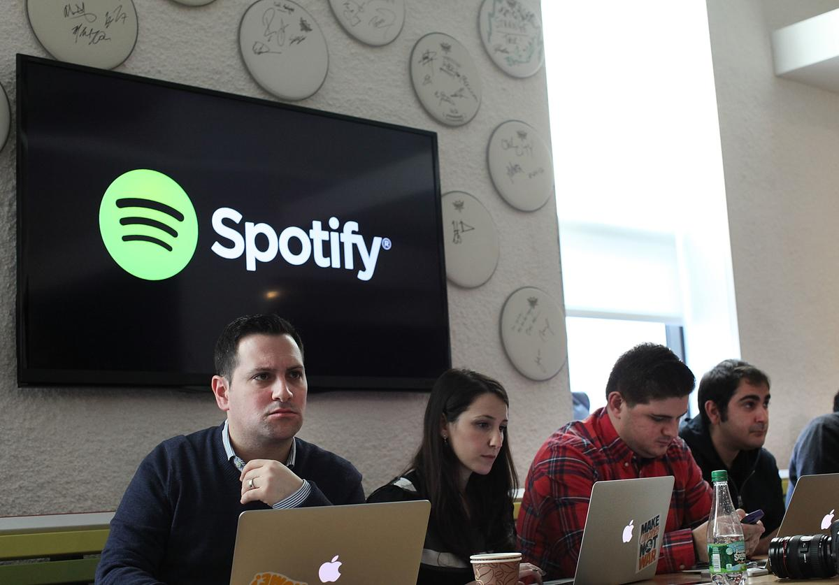 Social media bloggers listen as Spotify CEO Daniel Ek announces that the online streaming music service will expand to 20 new markets around the world and that it has worked out a deal with Led Zeppelin, which had so far refused to license its catalog for streaming on the service on December 11, 2013 in New York City