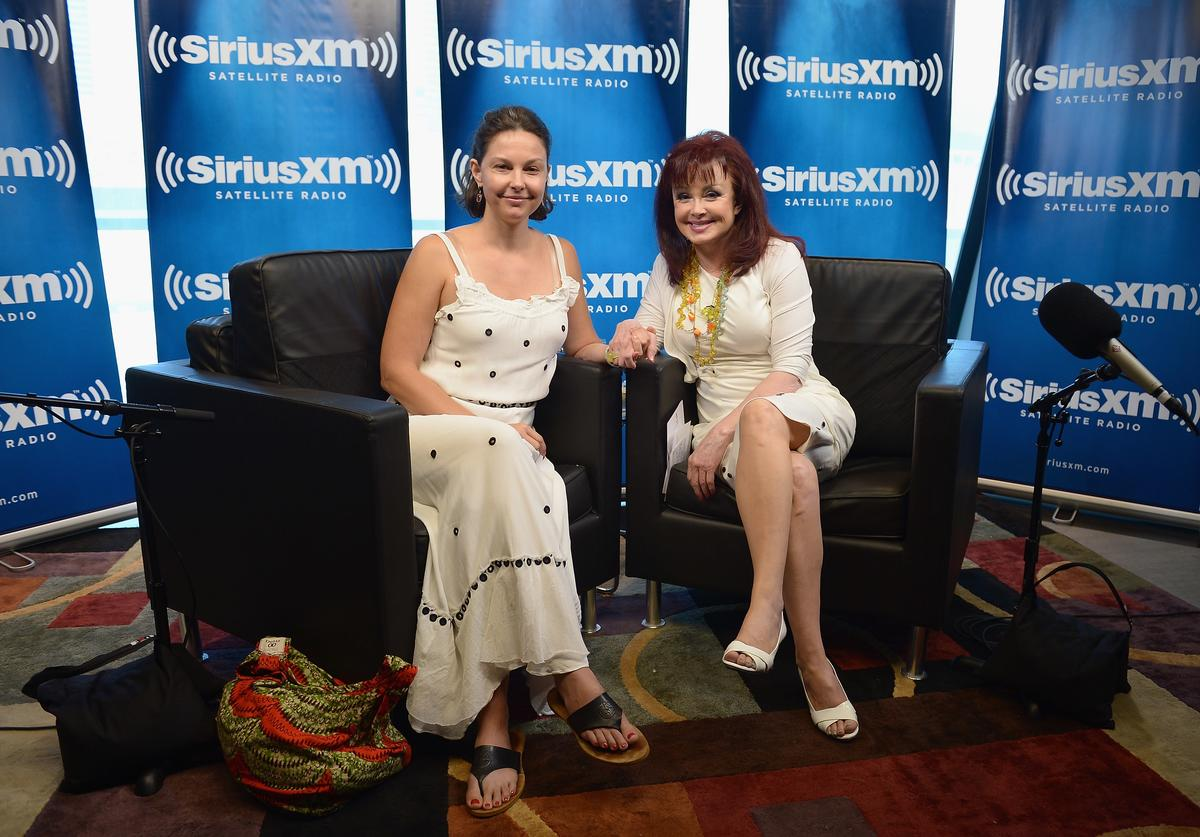 Actress Ashley Judd (L) and mother, singer Naomi Judd pose following the launch of Naomi's SiriusXM series 'Think Twice' at SiriusXM Music City Theater at the Bridgestone Arena on June 5, 2012 in Nashville, Tennessee