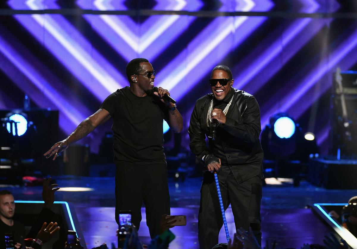 Recording artists Sean 'Puff Daddy' Combs (L) and Mase perform onstage at the 2015 iHeartRadio Music Festival at MGM Grand Garden Arena on September 19, 2015 in Las Vegas, Nevada
