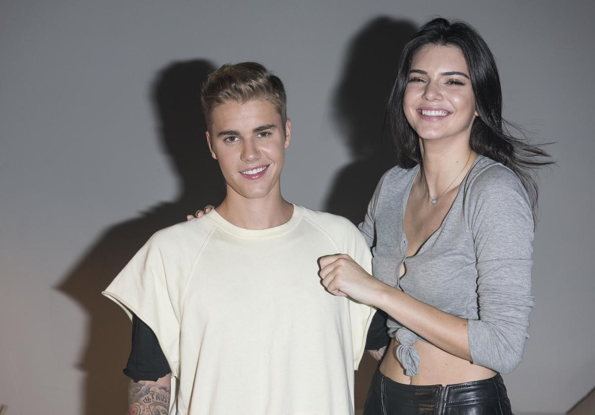 Justin Bieber and Kendall Jenner pose backstage at the Calvin Klein Jeans music event with special appearance from Justin Bieber and performances by Jay Park, Kevin Poon, Joon & Verbal at the Kai Tak Cruise Terminal, Hong Kong, Thursday, June 11, 2015