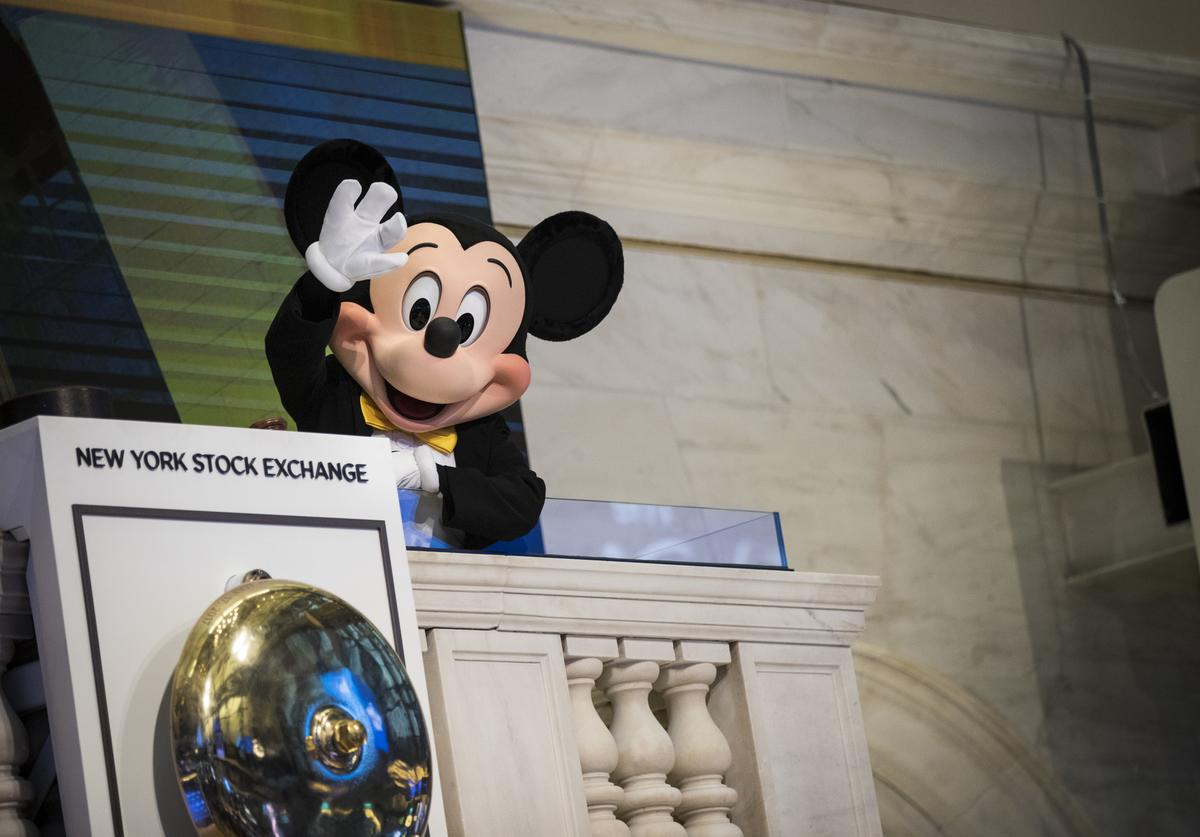 Mickey Mouse, the mascot of The Walt Disney Company, waves before ringing the opening bell at the New York Stock Exchange (NYSE), November 27, 2017 in New York City. Disney is marking the company's 60th anniversary as a listed company on the NYSE