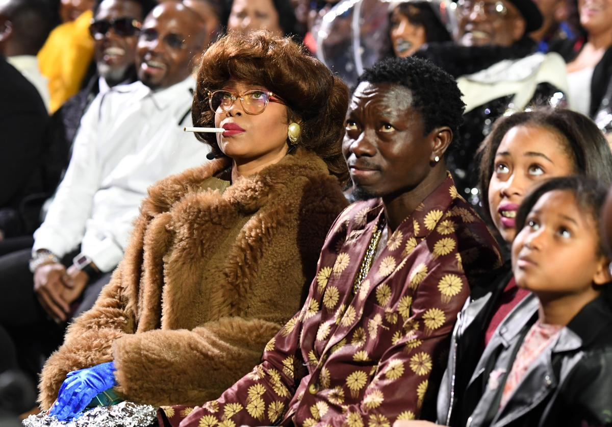 Host Erykah Badu (L) and Michael Blackson attend the 2017 Soul Train Awards, presented by BET, at the Orleans Arena on November 5, 2017 in Las Vegas, Nevada