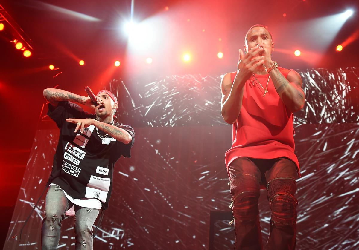 Chris Brown (L) and Trey Songz perform onstage during the 'Between The Sheets' tour at Barclays Center of Brooklyn on February 16, 2015 in New York City