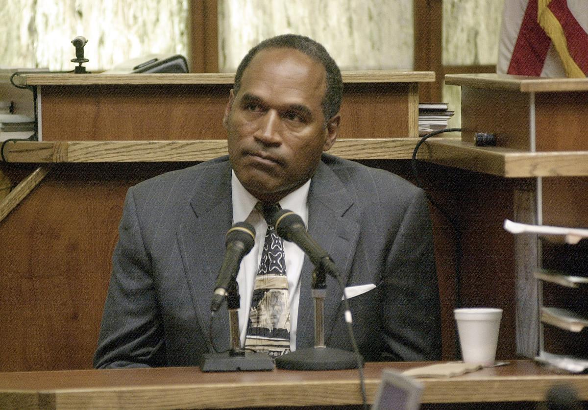 Former NFL star and actor O.J. Simpson takes the stand and answers questions in the second day of his 'road rage' trial before the Miami-Dade County Courtroom October 22, 2001 in Miami, FL. Simpson is on trial for allegedly attacking a Miami motorist in December 2000. If found guilty, Simpson faces up to 16 years in prison