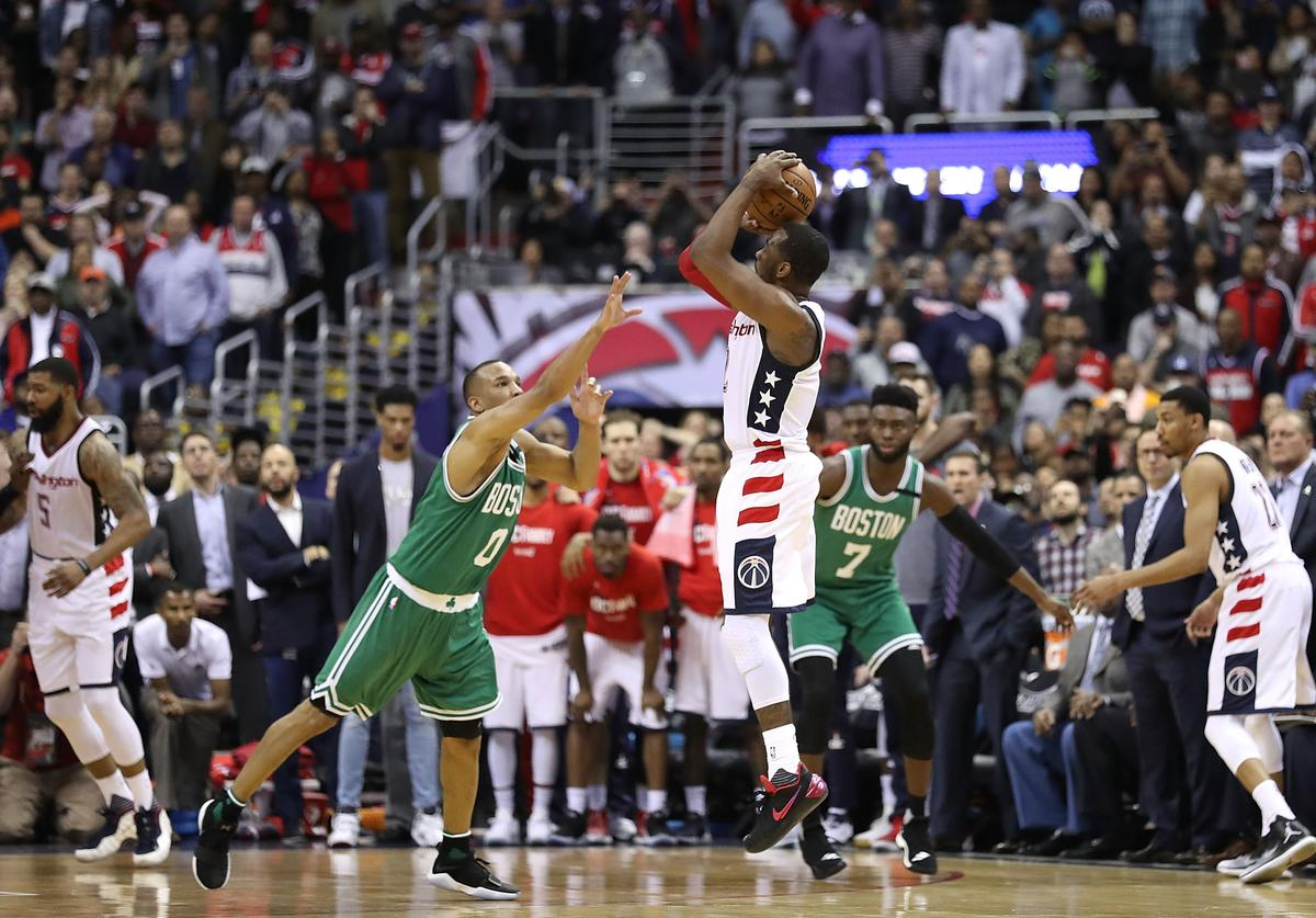 John Wall #2 of the Washington Wizards shoots the game-winning three-point basket against Avery Bradley #0 of the Boston Celtics during Game Six of the NBA Eastern Conference Semi-Finals at Verizon Center on May 12, 2017 in Washington, DC