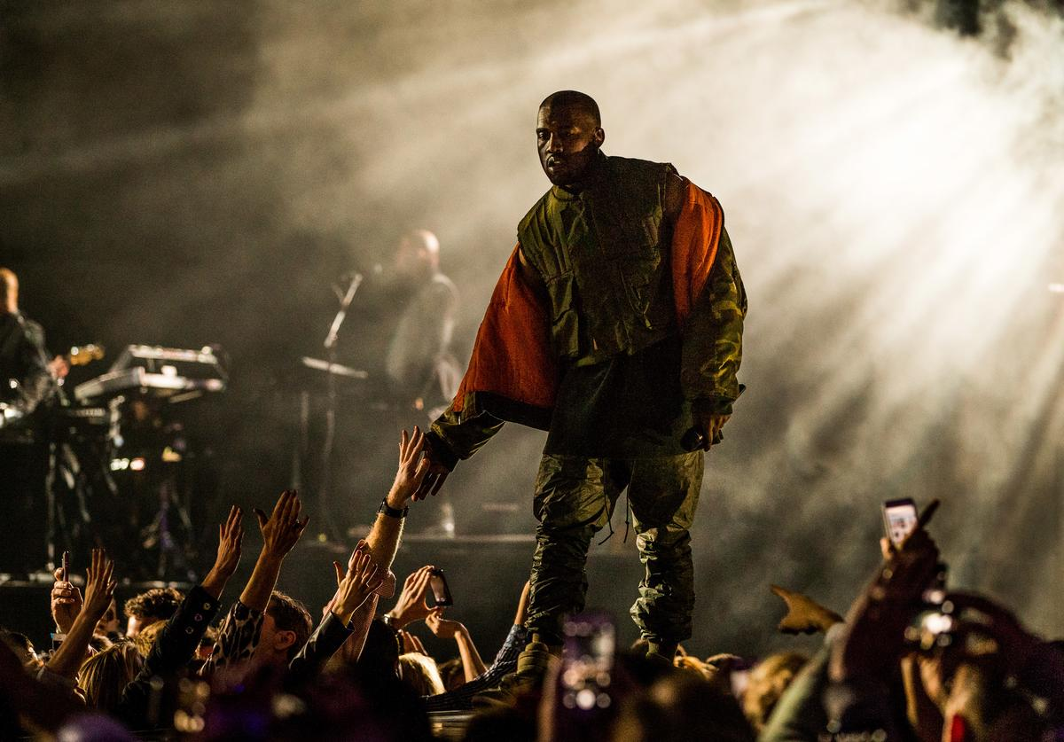 Recording artist Kanye West performs onstage during DirecTV Super Saturday Night hosted by Mark Cuban's AXS TV and Pro Football Hall of Famer Michael Strahan at Pendergast Family Farm on January 31, 2015 in Glendale, Arizona