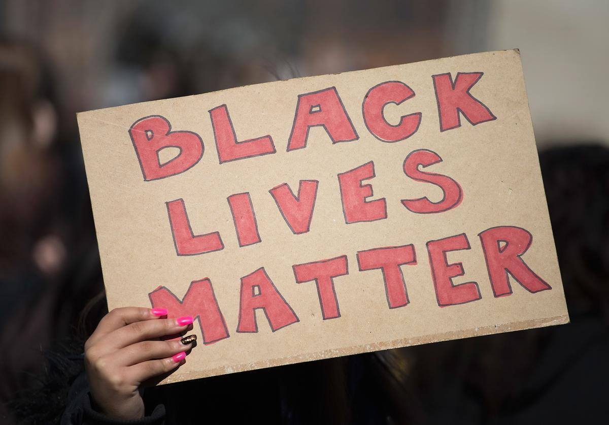 Demonstrators, most of whom are students who walked out of their classrooms today, protest outside of the City Hall building on March 9, 2015 in Madison, Wisconsin. The protestors were angry about the shooting death of 19-year-old Tony Robinson who was killed by Madison Police Officer Matt Kenny during a confrontation on March 6. The demonstrators also marched through the State Capital building during today's protest