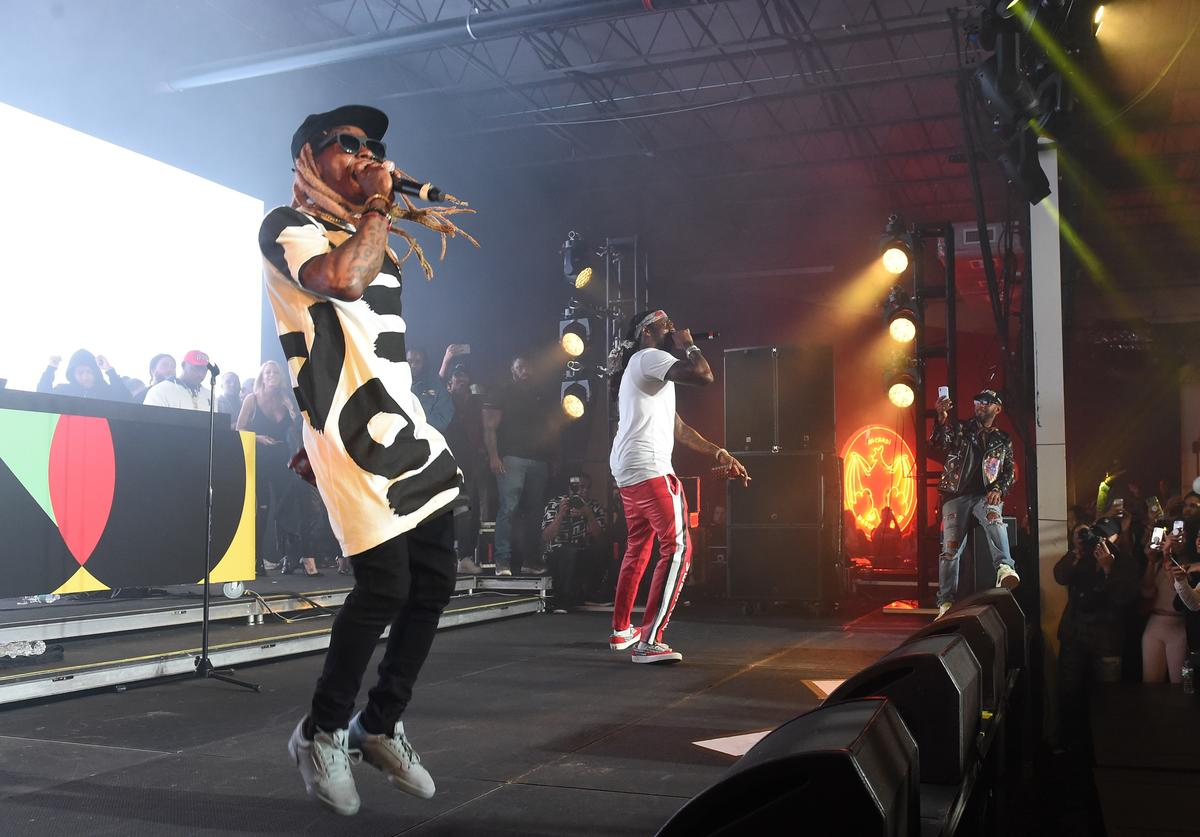 Lil Wayne and 2 Chainz perform onstage during BACARDI, Swizz Beatz and The Dean Collection bring NO COMMISSION back to Miami to celebrate 'Island Might' at Soho Studios on December 9, 2017 in Miami, Florida