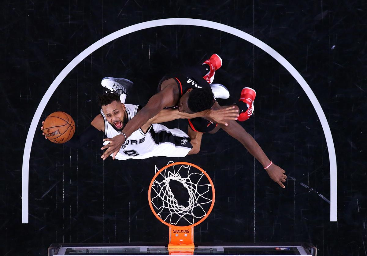 Patty Mills #8 of the San Antonio Spurs takes a shot against Clint Capela #15 of the Houston Rockets during Game Five of the Western Conference Semi-Finals at AT&T Center on May 9, 2017 in San Antonio, Texas
