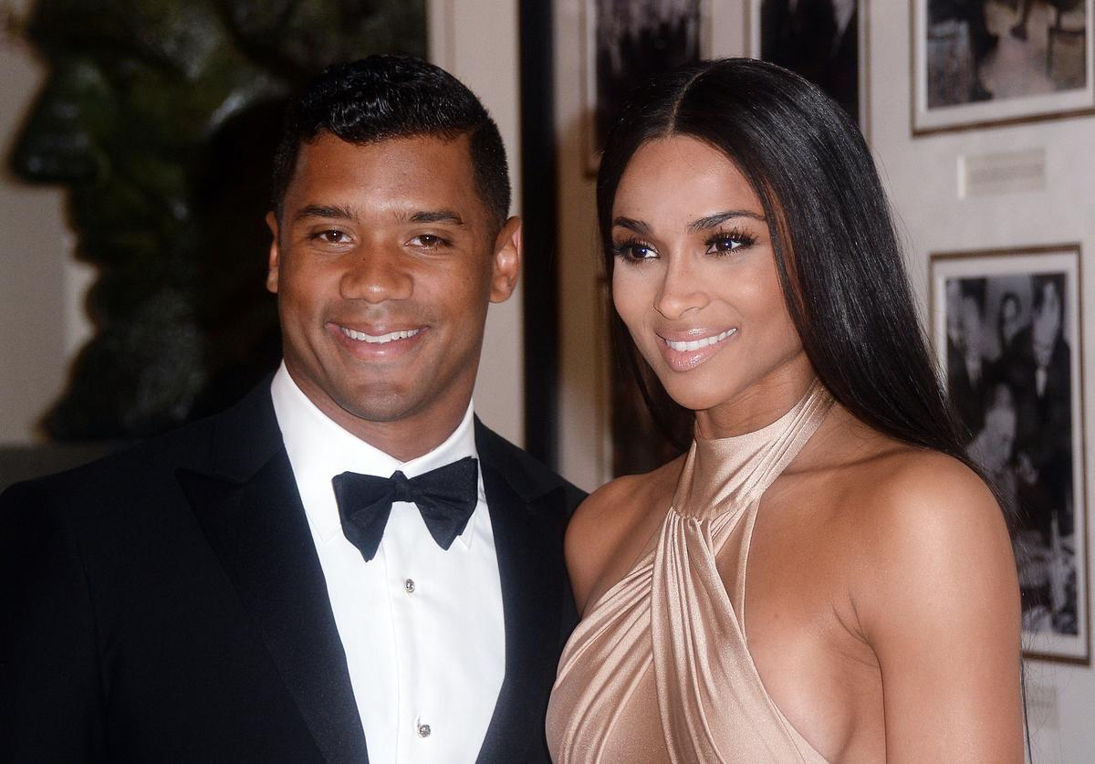 Russell Wilson from the Seattle Seahawks and Ciara Harris arrive for the State dinner in honor of Japanese Prime Minister Shinzo Abe And Akie Abe April 28, 2015 at the Booksellers area of the White House in Washington, DC