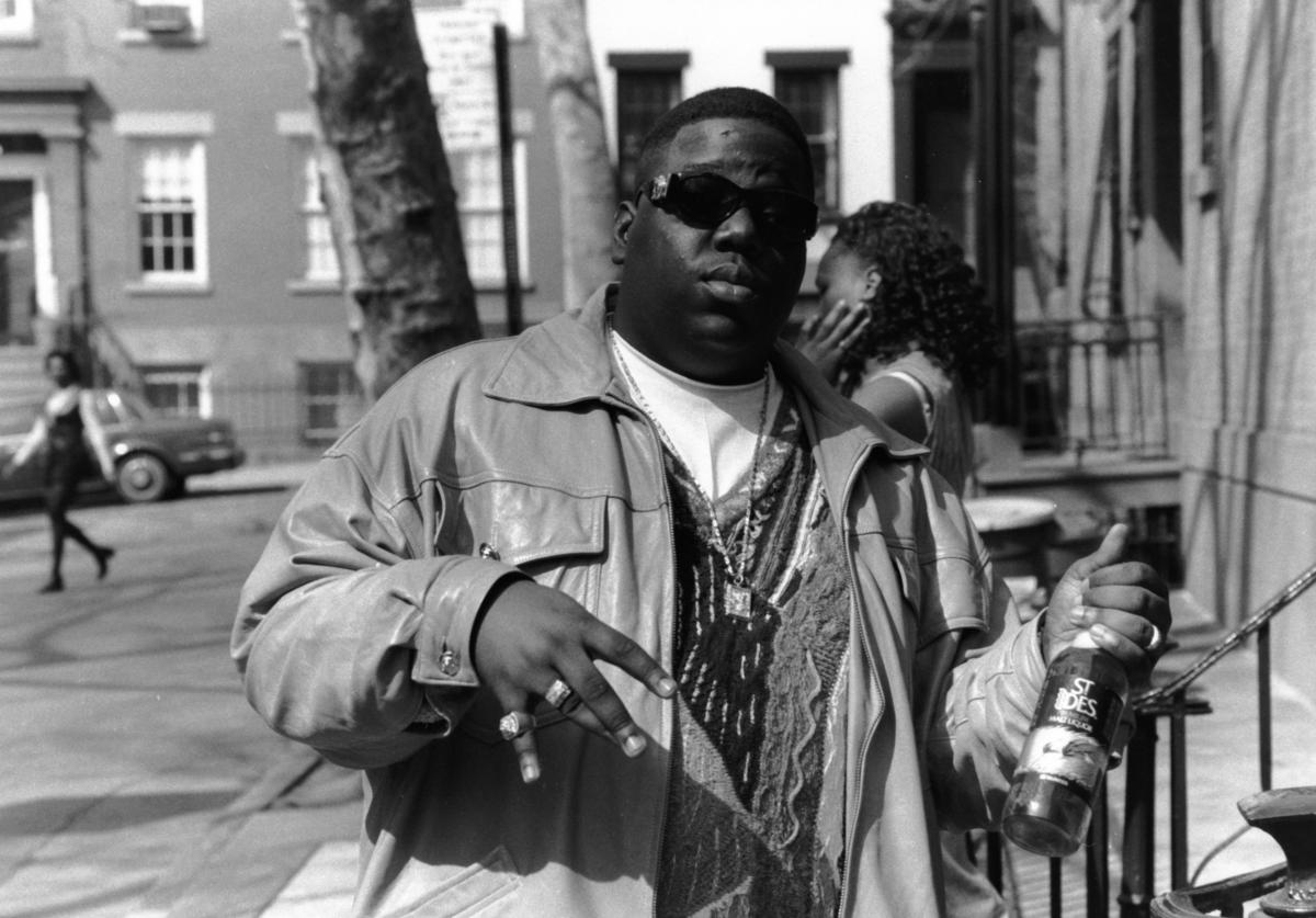 American rapper Biggie Smalls (also known as the Notorious B.I.G., born Christopher Wallace, 1972 - 1997) holds a bottle of St. Ides malt liquor, New York, New York, 1995