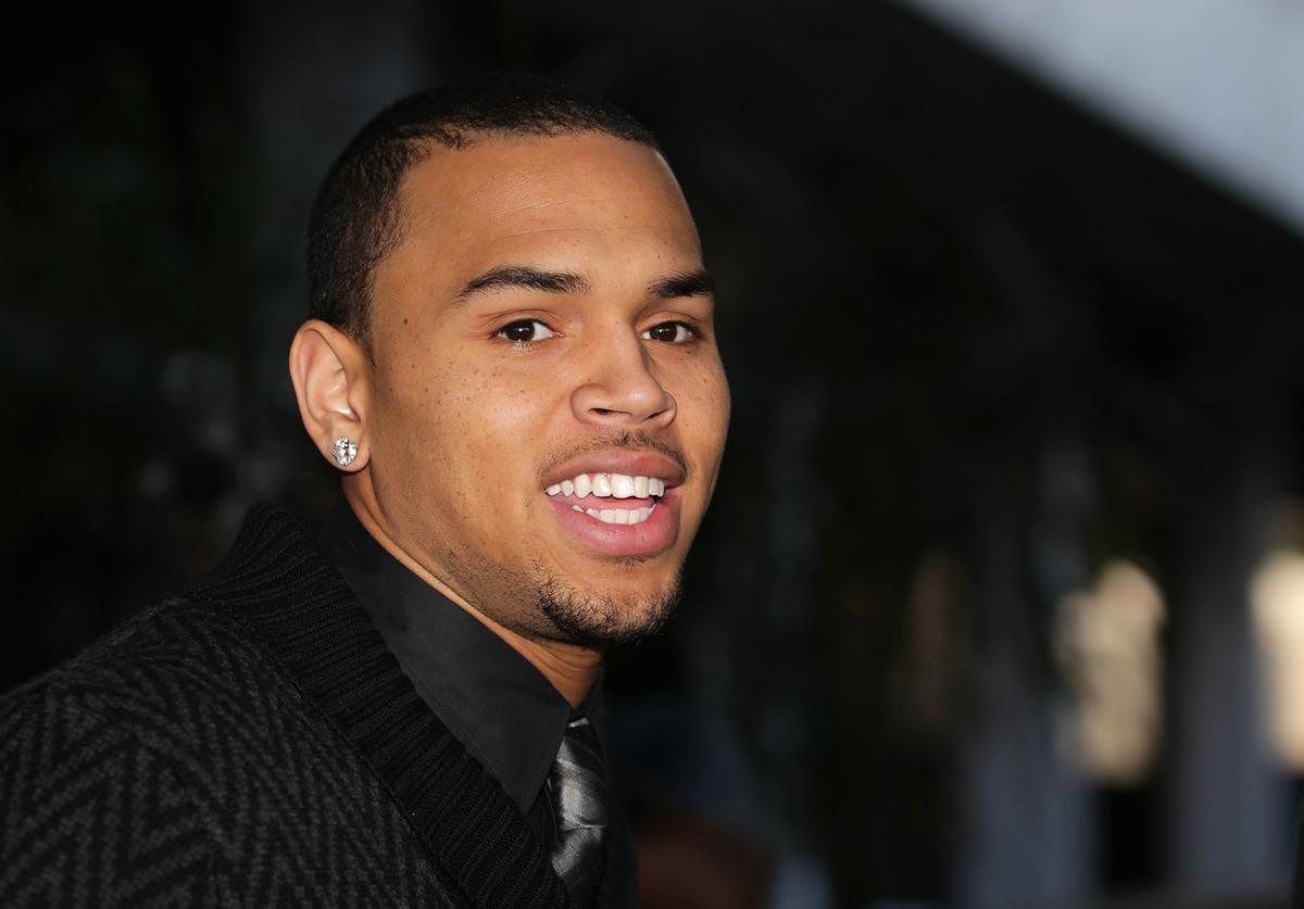 Recording artist Chris Brown leaves the Los Angeles courthouse after a probation progress hearing on January 28, 2011 in Los Angeles, California. Brown pleaded guilty to assaulting his then-girlfriend, singer Rihanna, after a pre-Grammy Awards party in 2009. He was given a sentence of five years probation and ordered to complete 180 days of community labor and a year of domestic violence counseling