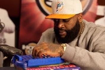 """Rick Ross Plays A Game Of """"Mastermind"""" With Angie Martinez"""