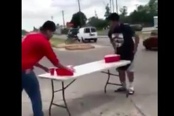 No Regard! Two Guys Play Beer Pong In The Middle Of A Busy Intersection