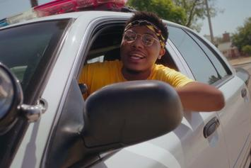 "Dreamville's Cozz Plays Role Reversal With Cops In New Video For ""Questions"""