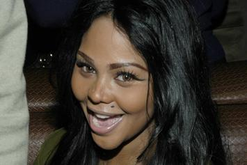 "Lil Kim Sues Lawyer, Says She's ""Just Getting Over"" Biggie's Death"