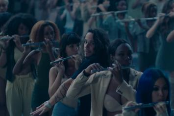 "Russ Calls All Wind Instruments To The Fore, In ""The Flute Song"" Video"