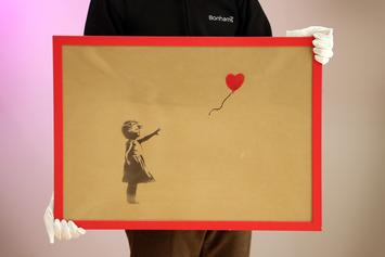 "Banksy Destroys ""Girl With A Balloon"" Painting After It Sells For $1.2 Million: Watch"