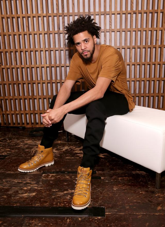 J. Cole at fashion event