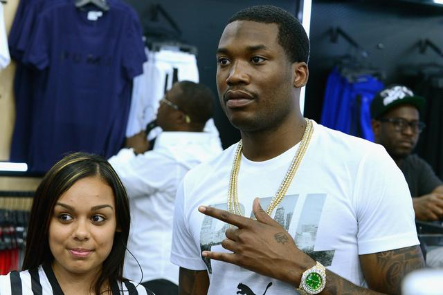 Meek Mill with a fan at Foot Locker