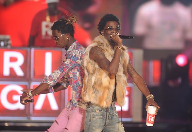 Rich Homie Quan and Young Thug onstage together in 2014