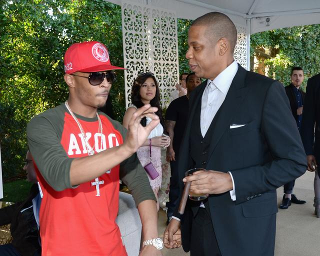 Jay Z and T.I. talking together
